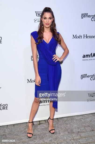 Iris Mittenaere attends the amfAR generationCURE Solstice 2017 at Mr Purple on June 20 2017 in New York City