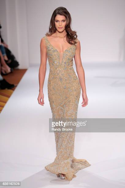 Iris Mittenaere walks the runway at the Sherri Hill NYFW Fall 2017 Runway Show during New York Fashion Week at Gotham Hall on February 13 2017 in New...