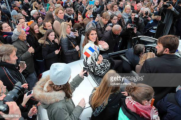 Iris Mittenaere waves to the crowd as she returns to her hometown of Lille northern France after being crowned Miss France 2016 at the weekend on...