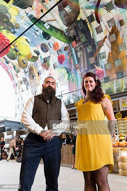 Iris Roskam and Arno Coenen responsible for the paintings and artwork attend the opening of the new Markthal on October 1 2014 in Rotterdam...