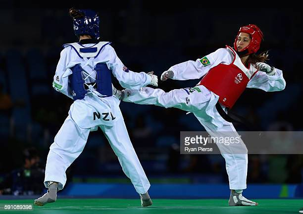 Iris Sing of Brazil kicks Andrea Kilday of New Zealand during the Taekwondo Women's 49kg Round One contest at Cairoca Arena 3 on August 18 2016 in...