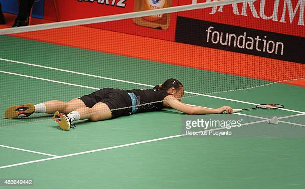 Iris Wang of USA falls during the game against Wang Shixian of China in the 2015 Total BWF World Championship at Istora Senayan on August 11 2015 in...