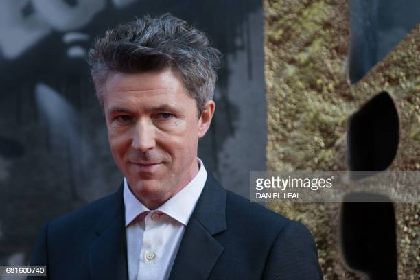 Irish actor Aidan Gillen poses for a photograph upon arrival at the European Premiere of 'King Arthur legend of the Sword' in London on May 10 2017 /...