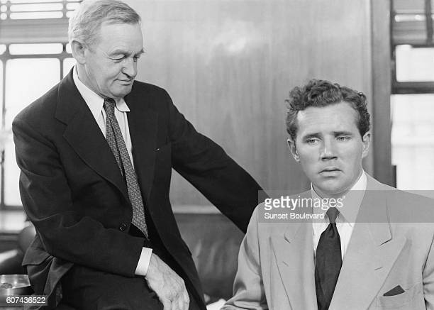 Irish actor Barry Fitzgerald and American actor Howard Duff on the set of The Naked City directed by Jules Dassin