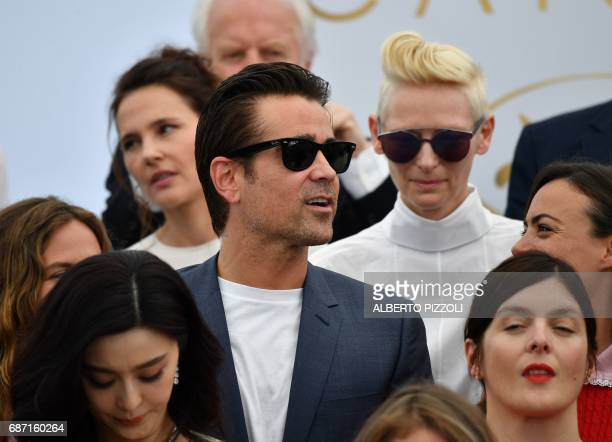 Irish actor Colin Farrell and British actress Tilda Swinton pose on May 23 2017 during a photocall for the '70th Anniversary' of the Cannes Film...