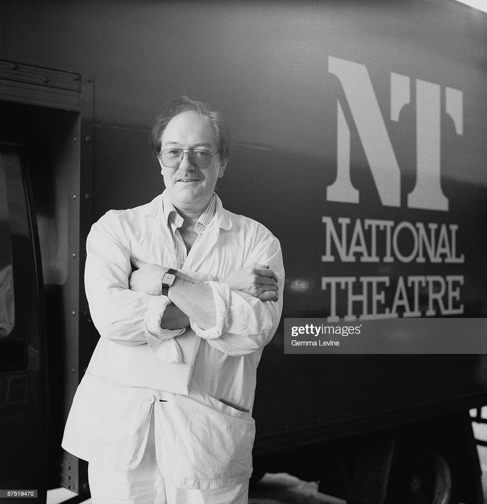 Irish actor Michael Gambon stands in front of a National Theatre van, circa 1985.