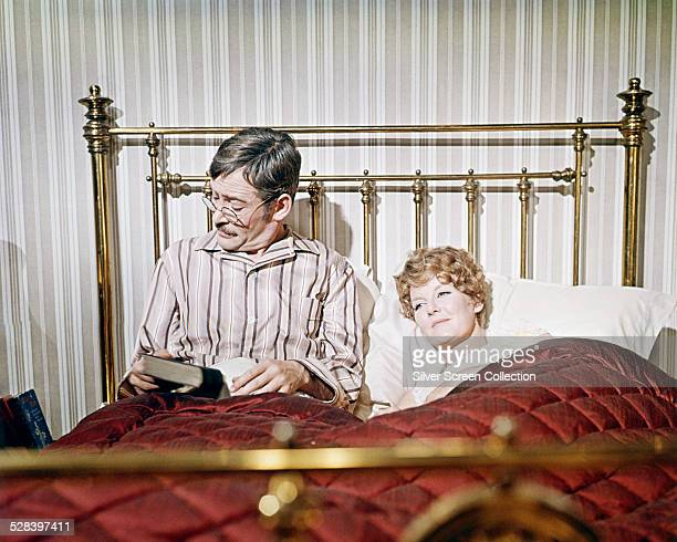 Irish actor Peter O'Toole as Arthur Chipping and English singer and actress Petula Clark as Katherine Bridges in a bedroom scene from 'Goodbye Mr...
