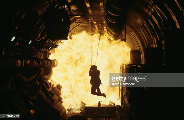 Irish actor Pierce Brosnan as 007 escapes from an exploding Russian missile base in a scene from the James Bond film 'The World Is Not Enough' 1999...