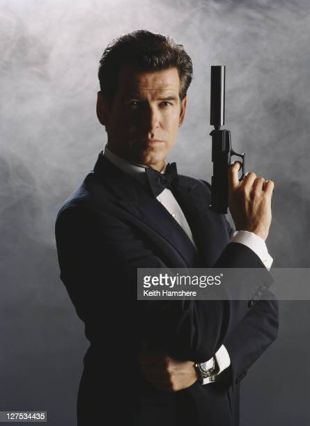 Irish actor Pierce Brosnan as 007 in a publicity still for the James Bond film 'The World Is Not Enough' 1999 He is wielding a Walther P99 with a...