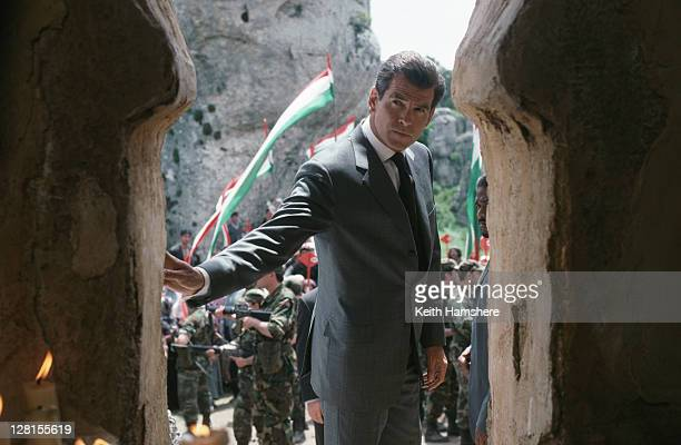 Irish actor Pierce Brosnan as 007 visits a local church situated on a planned pipeline construction site in a scene from the James Bond film 'The...