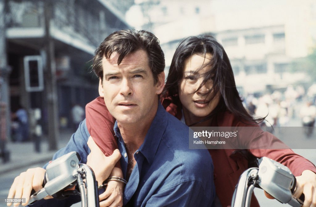 Irish actor Pierce Brosnan as 007 with Malaysian actress Michelle Yeoh as Wai Lin on location in Thailand for the James Bond film 'Tomorrow Never...