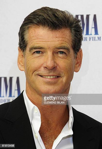 Irish actor Pierce Brosnan poses for photographers during a photocall to promote his film 'Mamma Mia' on July 3 2008 in Berlin The story based on the...