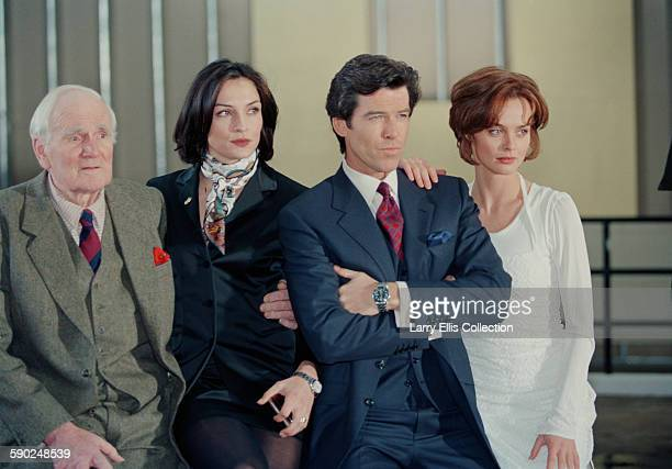 Irish actor Pierce Brosnan poses with his costars Desmond Llewelyn Famke Janssen and Izabella Scorupco during a publicity shoot for the James Bond...