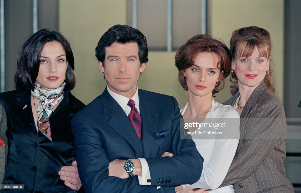 Irish actor Pierce Brosnan poses with his costars Famke Janssen Izabella Scorupco and Samantha Bond during a publicity shoot for the James Bond film...
