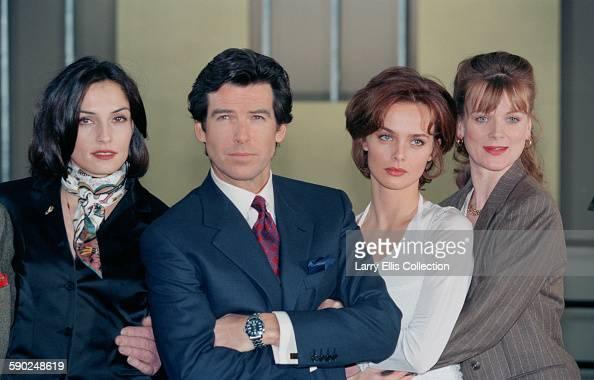 Irish actor Pierce Brosnan poses with his costars Famke Janssen Izabella Scorupco and Samantha Bond during a publicity shoot for the James Bond film...