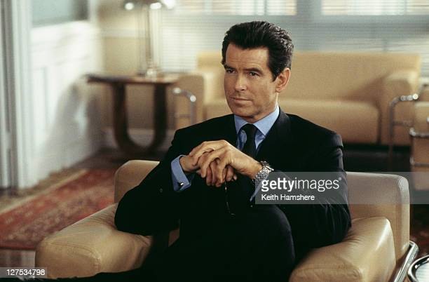 Irish actor Pierce Brosnan stars as 007 in the James Bond film 'The World Is Not Enough' 1999 Here he visits the offices of a Swiss banker in the...