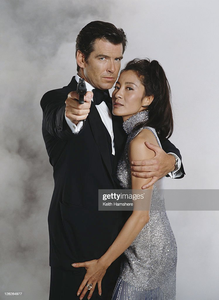 Irish actor <a gi-track='captionPersonalityLinkClicked' href=/galleries/search?phrase=Pierce+Brosnan&family=editorial&specificpeople=194774 ng-click='$event.stopPropagation()'>Pierce Brosnan</a> stars as 007 opposite Malaysian actress <a gi-track='captionPersonalityLinkClicked' href=/galleries/search?phrase=Michelle+Yeoh&family=editorial&specificpeople=223894 ng-click='$event.stopPropagation()'>Michelle Yeoh</a> in the James Bond film 'Tomorrow Never Dies' 1997. He is holding a Walther P99 semi-automatic pistol.