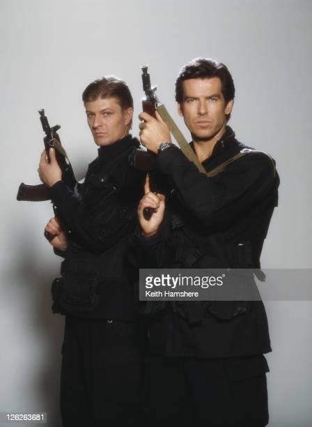 Irish actor Pierce Brosnan stars as James Bond opposite English actor Sean Bean as Alec Trevelyan both holding Kalashnikov rifles in the film...