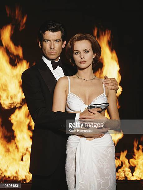 Irish actor Pierce Brosnan stars as James Bond opposite Polish actress Izabella Scorupco in the film 'GoldenEye' 1995 He is holding his iconic...