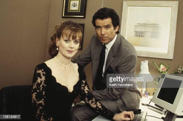Irish actor Pierce Brosnan stars as James Bond with actress Samantha Bond as Miss Moneypenny ina publicity still for the film 'GoldenEye' 1995