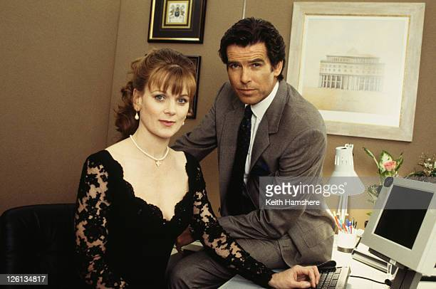 Irish actor Pierce Brosnan stars as James Bond with actress Samantha Bond as Miss Moneypenny ina publicity still for the film 'GoldenEye' 1995