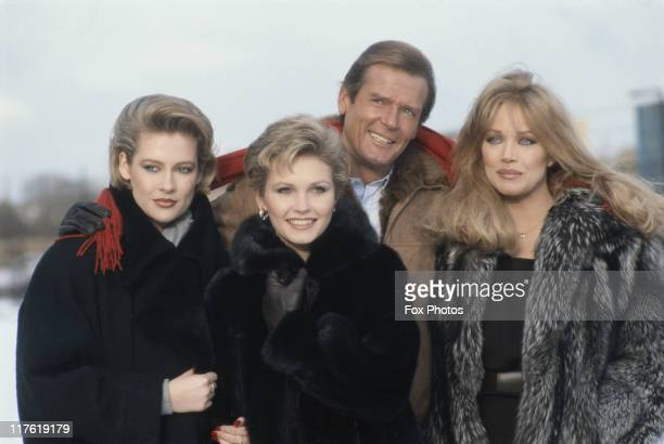 Irish actress Alison Doody British actress Fiona Fullerton British actor Roger Moore and US actress Tanya Roberts pose for a group portrait at...