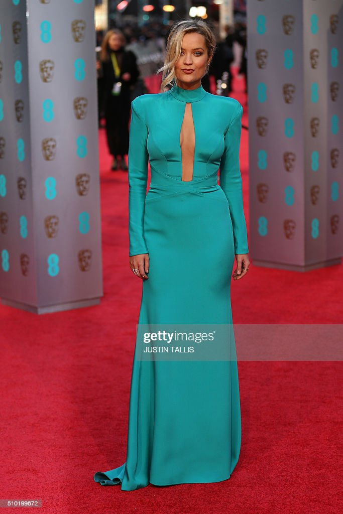 Irish actress Laura Whitmore poses on arrival for the BAFTA British Academy Film Awards at the Royal Opera House in London on February 14, 2016. TALLIS