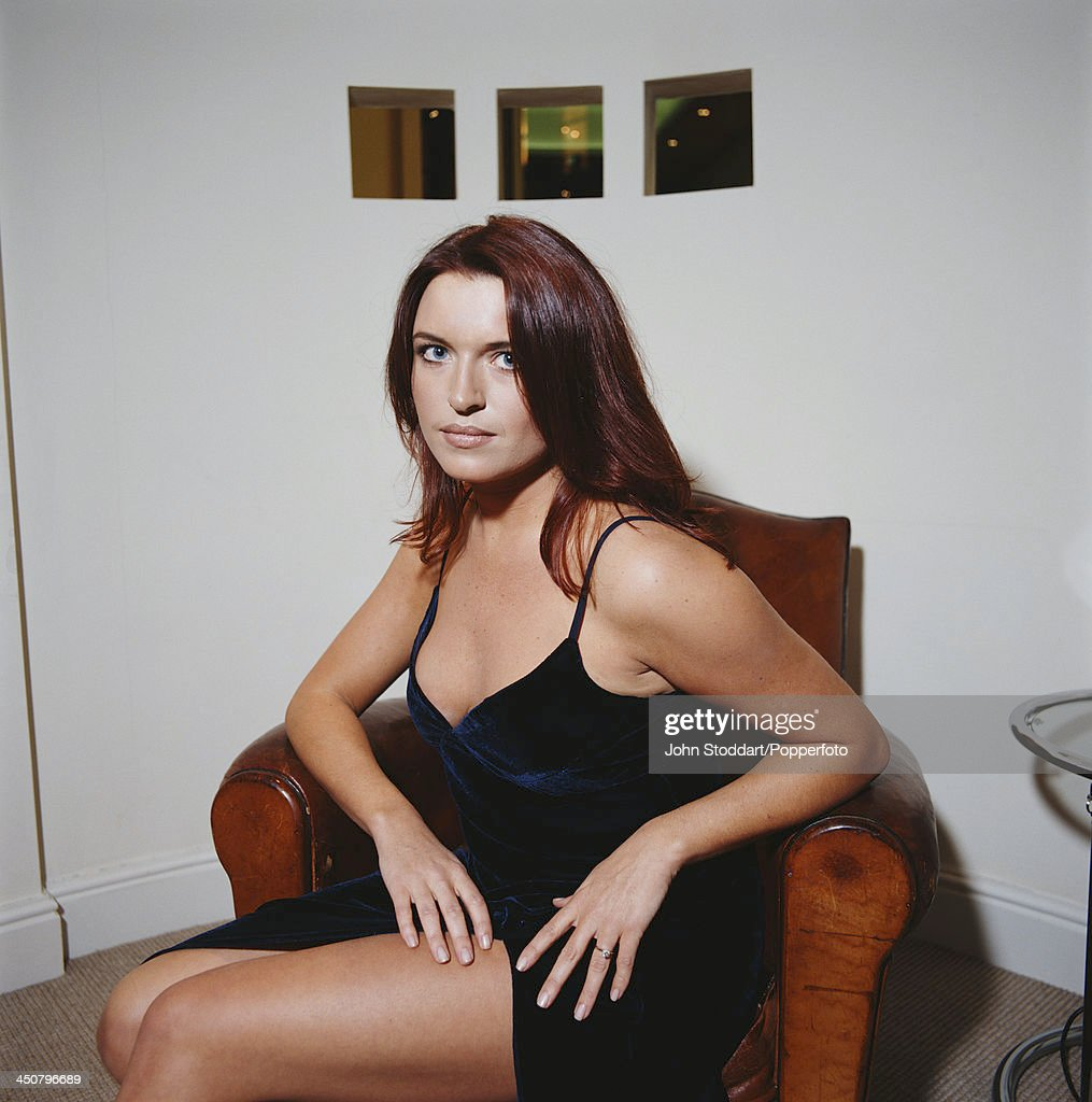 Irish actress Tina Hobley poses on an armchair, circa 1996.