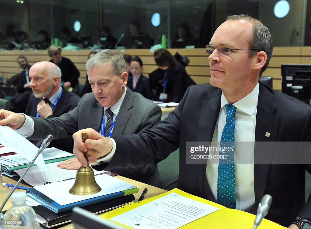 Irish Agriculture Marine and food Minister Simon Coveney rings the bell at the beginning of an European Union's Agriculture ministers meeting, on January 28, 2013 at the EU Headquarters in Brussels. The Council will hold an exchange of views on the Irish presidency's work programme for the reform of the Common Fisheries Policy (CFP) and on the key issues requiring further discussion in this context, following the general approaches reached last year by the Council on the CFP reform proposals. AFP PHOTO GEORGES GOBET