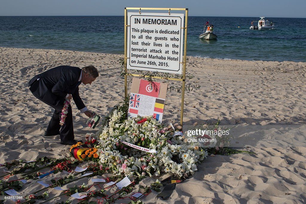 Irish Ambassador to Tunisia David Cooney lays flowers and shells for the Irish victims of the 2015 Sousse Beach terrorist attack during a memorial service on the beach in front of the Imperial Marhaba hotel on June 26, 2016 in Sousse, Tunisia. Today marks the one year anniversary of the Sousse Beach terrorist attack, which killed 38 people including 30 Britons. Before the 2011 revolution, tourism in Tunisia accounted for approximately 7% of the countries GDP. The two 2015 terrorist attacks at the Bardo Museum and Sousse Beach saw tourism numbers plummet even further forcing hotels to close and many tourism and hospitality workers to lose their jobs.