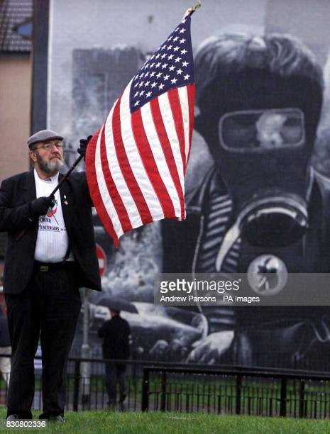 Irish American retired Police Chief Jerry O'Keefe from Anaheim California holds up the American flag at Free Derry Corner during the service to mark...