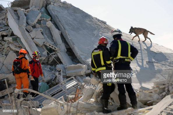 Irish and Spanish rescuers look for bodies in a collapsed building in PortauPrince on January 16 four days after a 70magnitude earthquake struck hard...