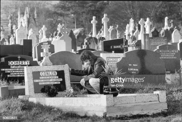 Irish author Gerry Conlon pays respects at the grave of his father Guiseppe at Milltown cemetery Belfast Ireland January 7 1994 Conlon a member of...