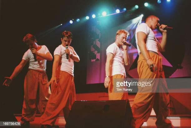 Irish band Boyzone perform on stage during their tour 1996 L R Mikey Graham Stephen Gately Ronan Keating Shane Lynch