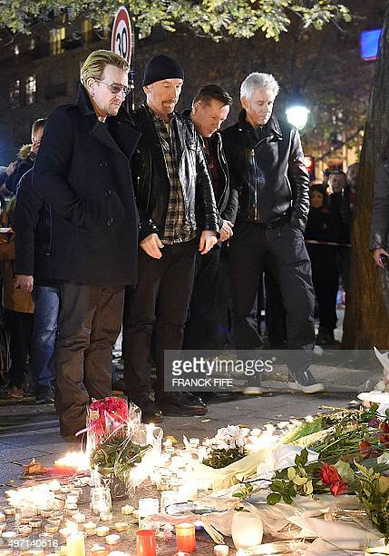 Irish band U2 lead singer Bono guitarist The Edge drummer Larry Mullen Jr and bass player Adam Clayton pay homage to attacks' victims near the...