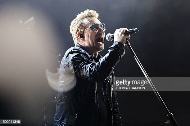 Irish band U2 singer Bono performs on stage at the Bercy Accordhotels Arena in Paris on December 6 2015 / AFP / THOMAS SAMSON