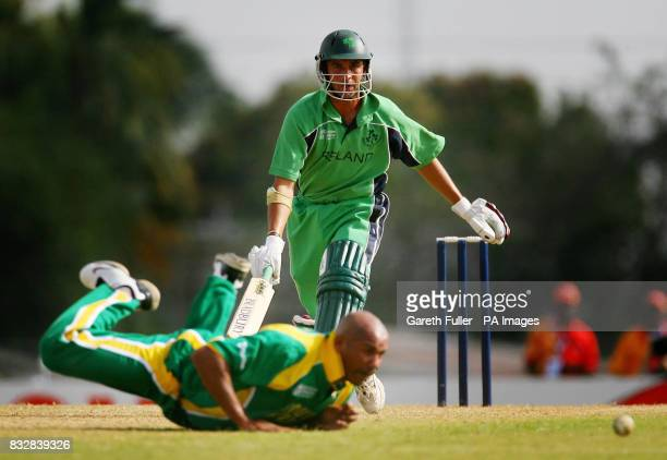 Irish batsman Andre Botha has his shot stopped by South Africa bowler Roger Telemachus during the World Cup warmup match at the Sir Frank Worrell...