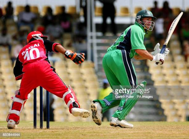 Irish batsman Jeremy Bray in action against Canada's wicketkeeper Ashish Bagai during their warmup game at St Augustine Trinidad