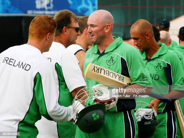 Irish batsman Jeremy Bray is congratulated by teammates on his 41 runs to help Ireland win their warmup match against Canada at St Augustine Trinidad
