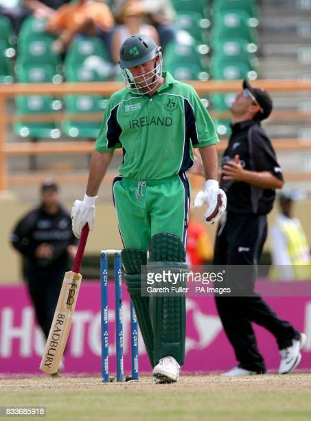 Irish batsman Jeremy Bray leaves the field after losing his wicket to New Zealand's Shane Bond during the ICC Cricket World Cup Super Eight match at...