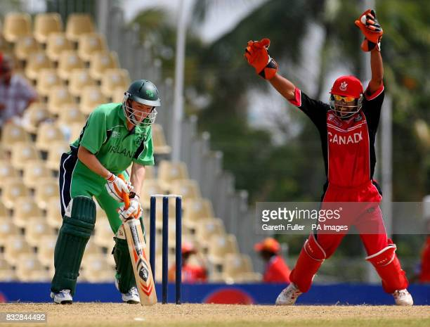 Irish batsman Niall O'Brien is caught out by Canada's wicketkeeper Ashish Bagai during their warmup game at St Augustine Trinidad