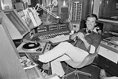 Irish born radio broadcaster Terry Wogan pictured in the BBC Radio 2 studios at Broadcasting House in London on 12th August 1976
