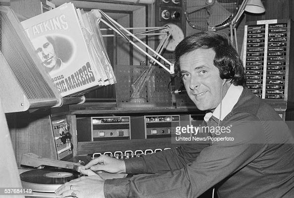Irish born radio broadcaster Terry Wogan pictured playing a record on a turntable in the BBC Radio 2 studios at Broadcasting House in London on 12th...