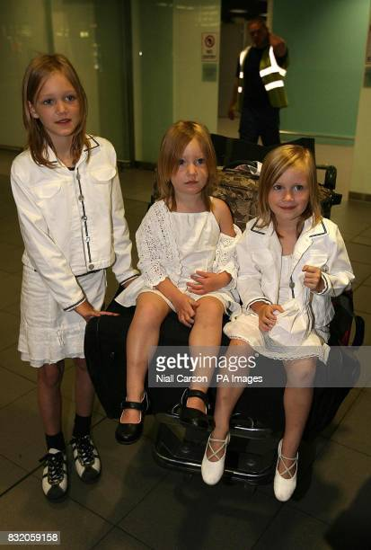 Irish children Clara Shauna and Emily Murphy arrive home to Dublin airport after they were evacuated from Lebanon with their mother Colette by the...