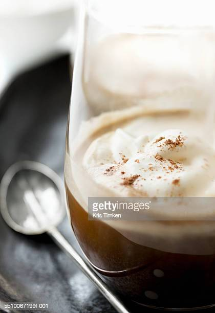 Irish coffee with whipped cream and nutmeg, close-up