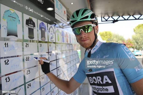 Irish cyclist and general classification leader Sam Bennett of BoraHansgrohe signs the board ahead of the next round of Fethiye Marmaris lap...