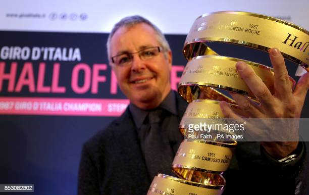 Irish Cyclist Stephen Roche holds the Giro d'Italia trophy at Bushmills Causeway hotel in Co Antrim as he becomes a member of the Giro D'Italia...