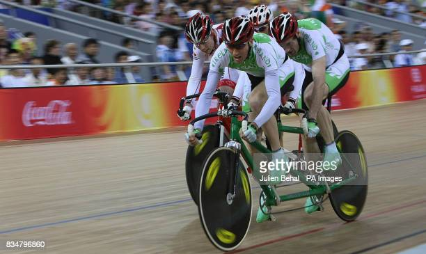 Irish cyclists David Peelo and Michael Delaney compete in the Mens Sprint BVI with Canada closing in behind them in the Laoshan Velodrome at the...