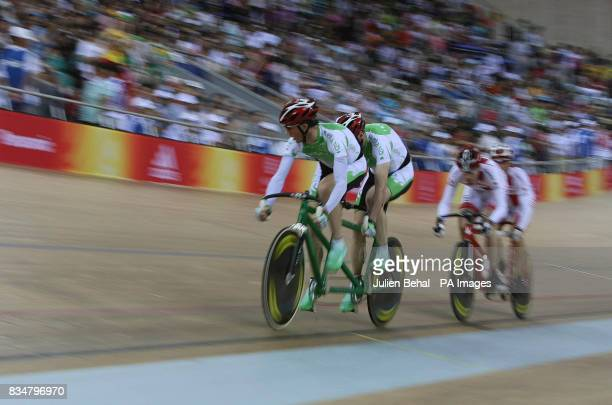 Irish cyclists David Peelo and Michael Delaney competiting in the Mens Sprint BVI with Canada closing in behind in the Laoshan Velodrome at the...