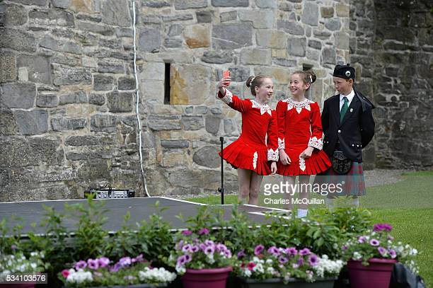 Irish dancers due to perform for Prince Charles Prince of Wales and Camilla Duchess of Cornwall take selfies on a smartphone before the royal couple...